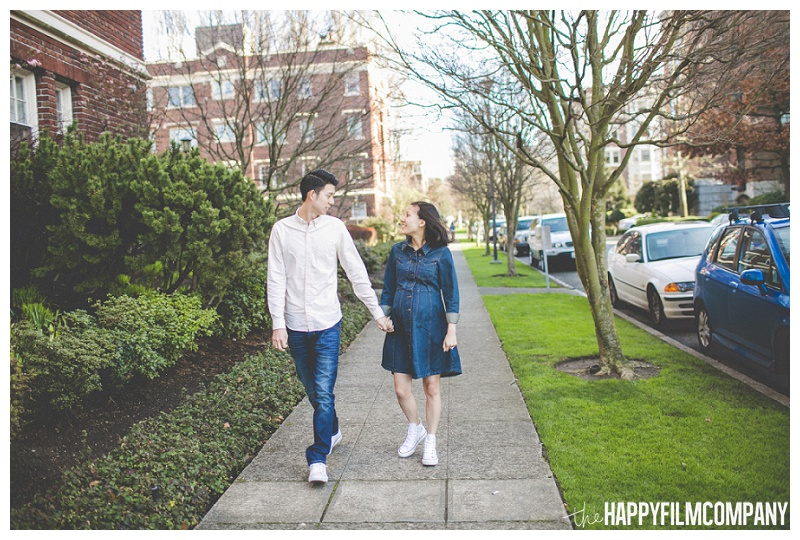 couple walking down sidewalk street maternity  - the Happy Film Company - Seattle Maternity Photography