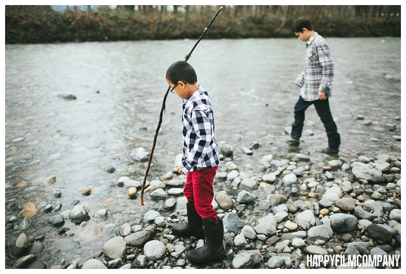 boys playing with sticks at the river  - the Happy Film Company - Seattle Family Photos