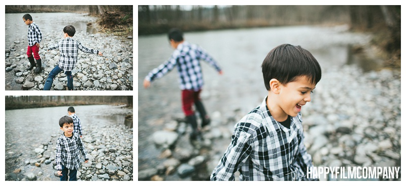 boys throwing rocks into river plaid shirts - the Happy Film Company - Seattle Family Photos
