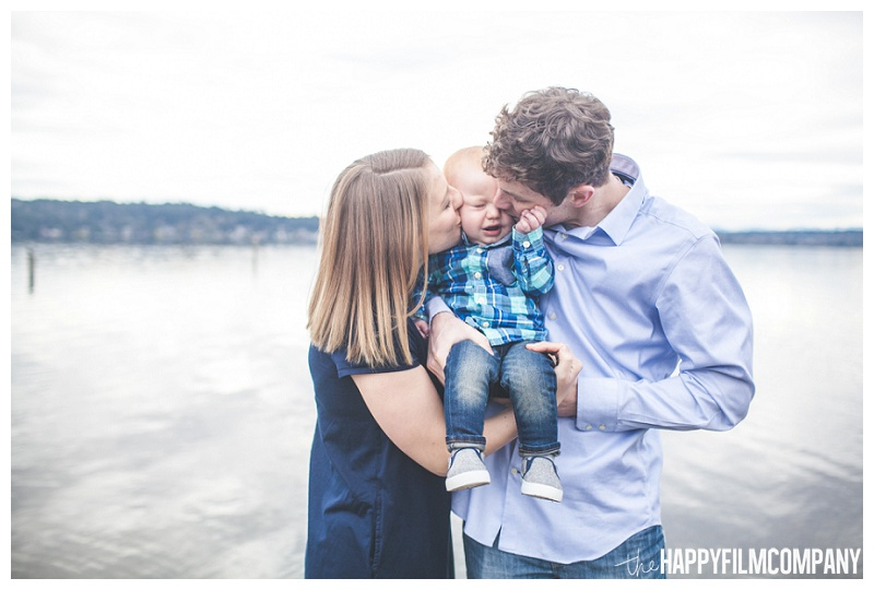 matthews beach family photos - mom and dad kissing baby on cheeks  - the Happy Film Company - Seattle PEPS Group Photo Shoot