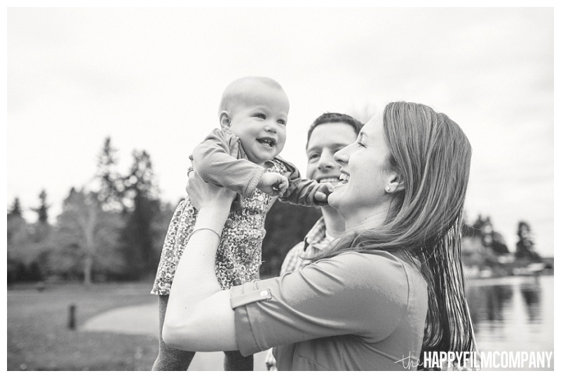 black and white holding baby up in the air smiling happy seattle family photos  - the Happy Film Company - Seattle PEPS Group Photo Shoot