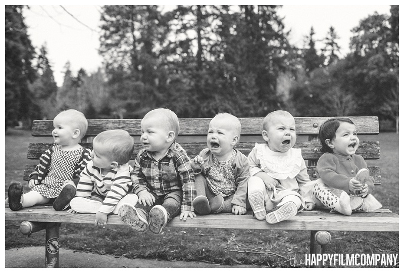 babies sitting on bench crying in park black and white funny  - the Happy Film Company - Seattle PEPS Group Photo Shoot
