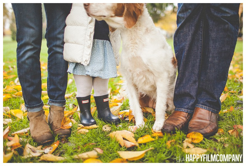 Family standing on leaves with pet- the Happy Film Company - Why It's a Good Idea to Include Dog in Your Family Portraits