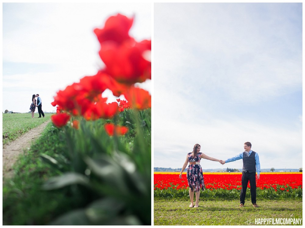 Holding hands in the row of red tulips - the Happy Film Company - Seattle Family Photography