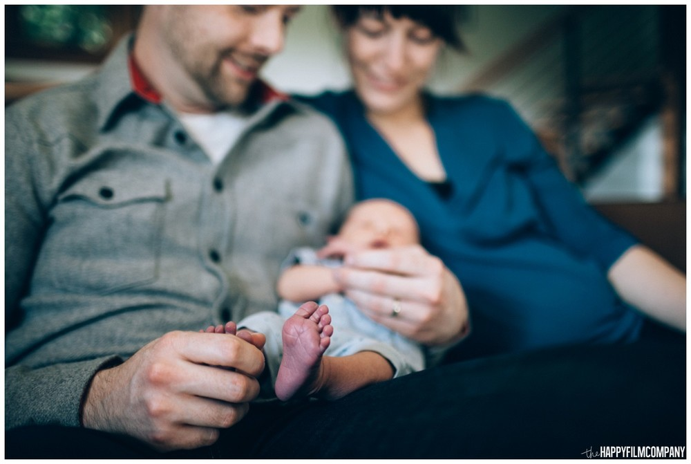 Mom and dad with their newborn baby - the Happy Film Company - Seattle family photos