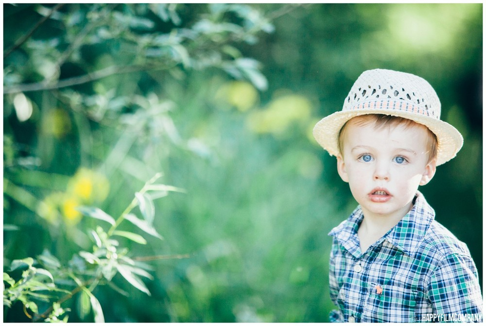 Cute little boy - wearing button up shirt and straw hat - the Happy Film Company - Seattle Family Photos