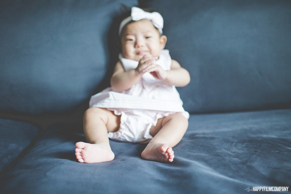 Cute baby girl sitting in the couch - the Happy Film Company - Seattle Family Photos
