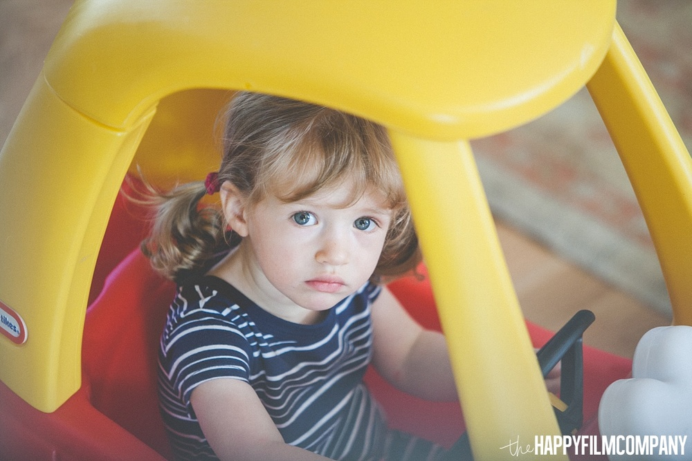 Little girl riding on the mini car - the Happy Film Company- Seattle Family Photos