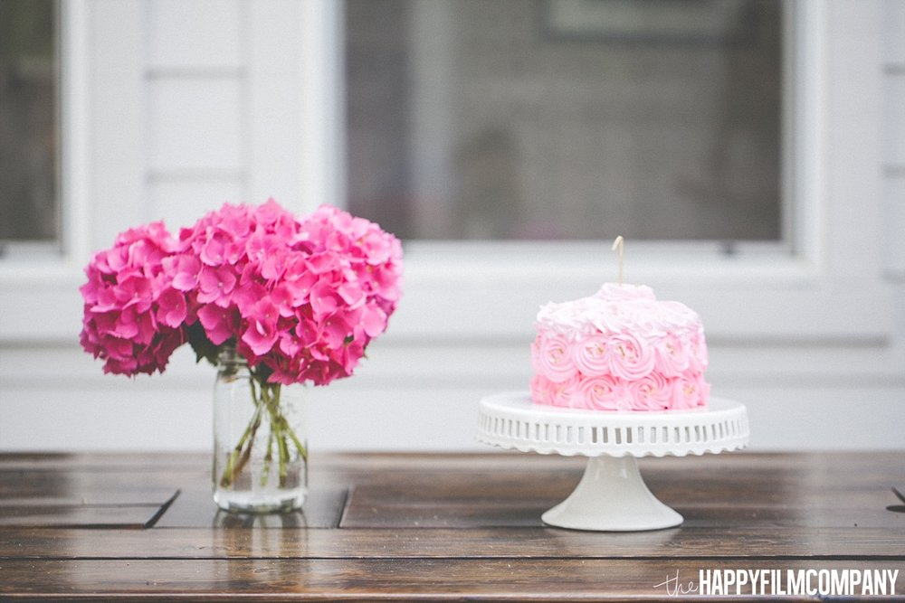 Pink cake and pink flower - the Happy Film Company - Seattle Family Photos