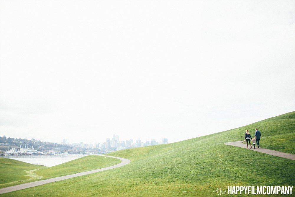 Family Walking in the big grassy hill - the Happy Film Company - Seattle Family Photos