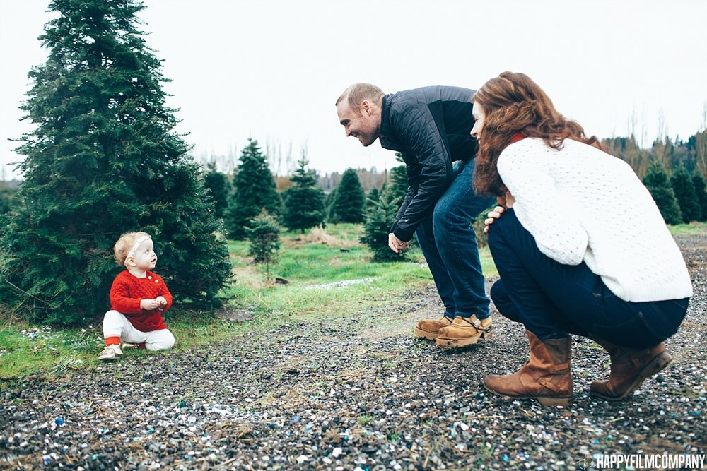Baby girl crawling on the ground - Seattle Family Photos at the Christmas Tree Farm