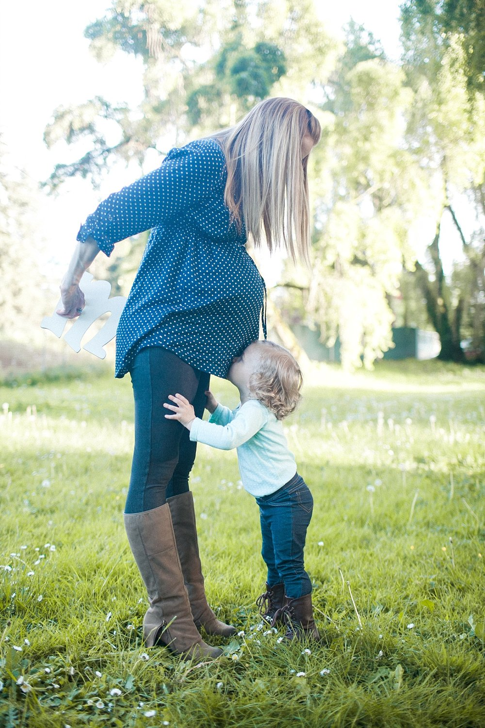 the Happy Film Company -  Seattle family photography - little girl kissing mommy's tummy
