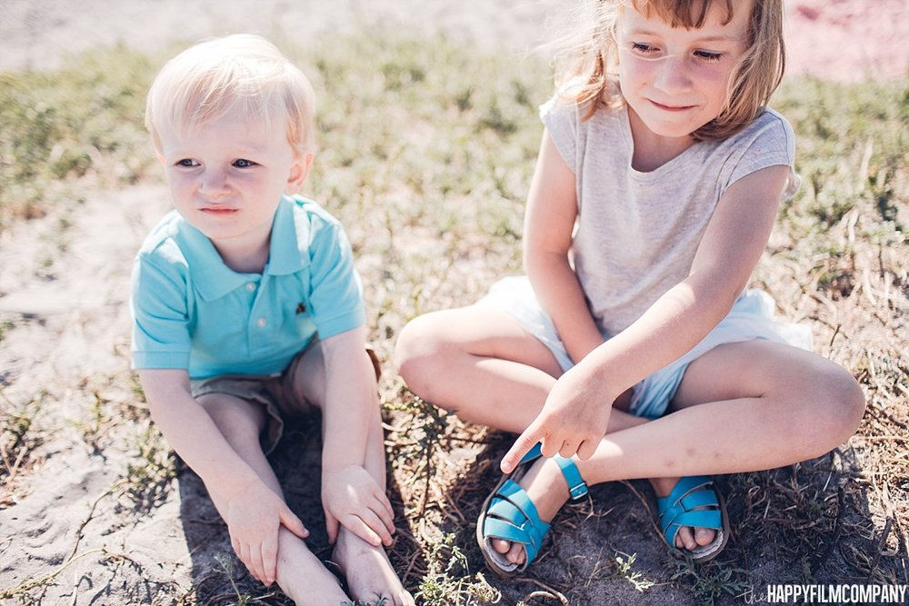 Little girl and little boy sitting in the ground - the Happy Film Company - Seattle Family Photos