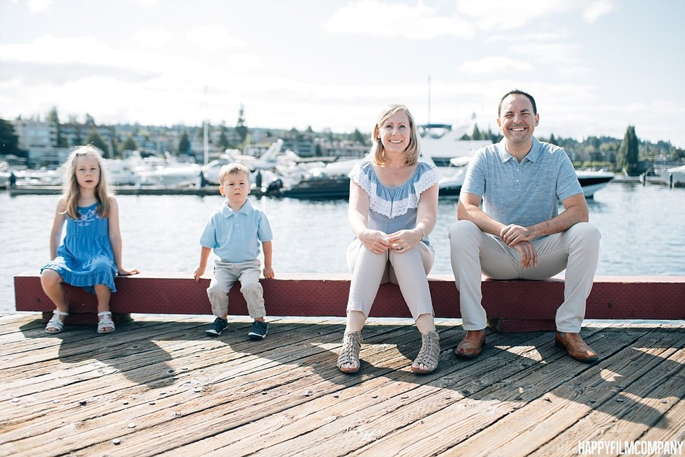 Family sitting by the boat dock - the Happy Film Company - Seattle Family Photos