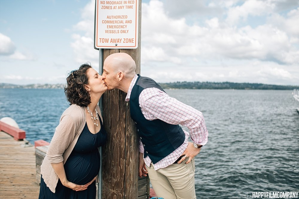 Couple kissing by the water - boat dock - the Happy Film Company - Seattle Family Photos