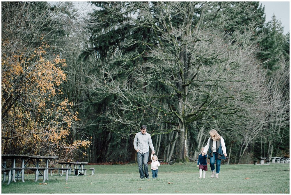 the Happy Film Company - St. Edwards Park - Seattle Family Photography - family in green field walking