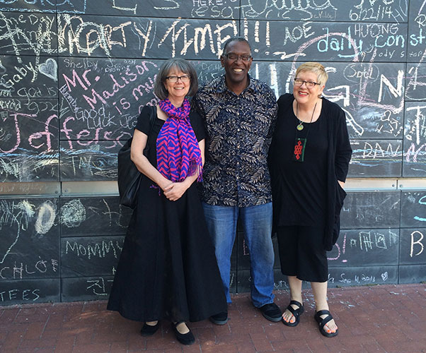 Monica Snellings,  John Hunter  and DK Holland in front of the Wall of Free Speech in Charlottesville, VA in May