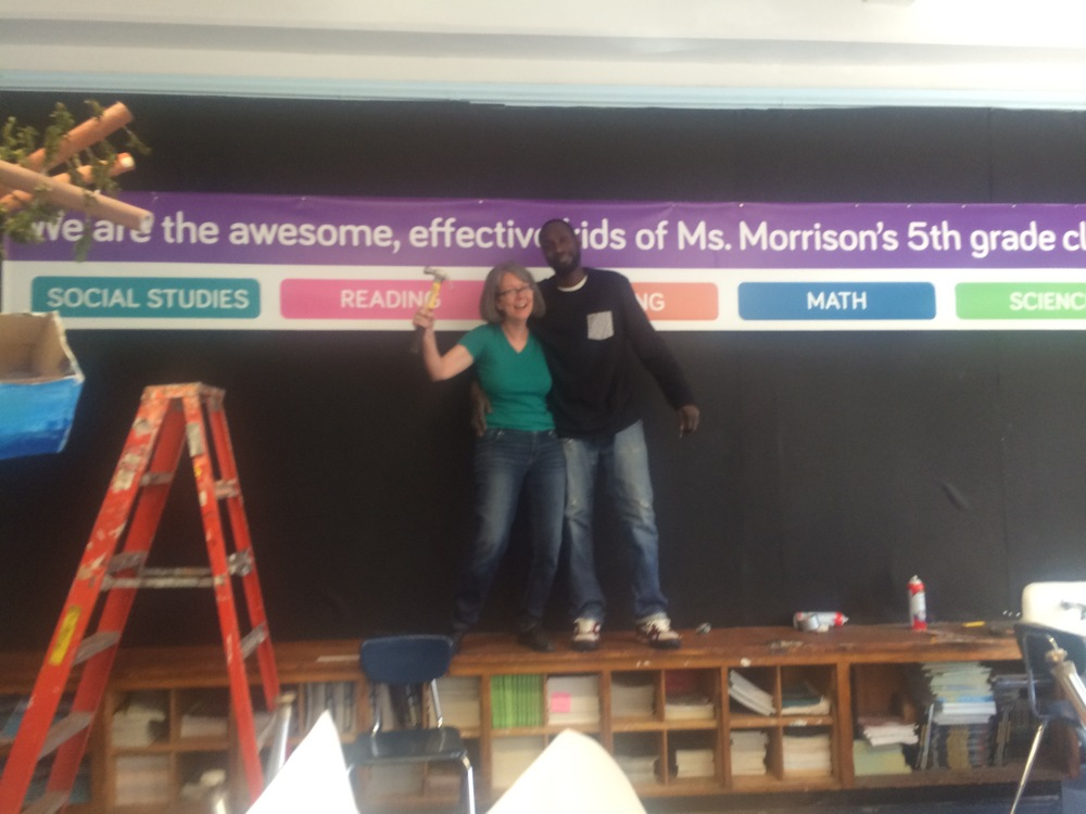 Monica Snellings and Nate the custodian completed the installation of the banner. This was no mean feat.