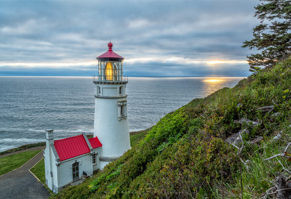 Heceta Head Lighthouse - taken May 19, 2015, at the end of one of my favorite days on the Oregon trip.  This is one of those lighthouses that has been photographed millions of times, from every angle imaginable.  I still like this image, and the sunbeams in the background really complete it.