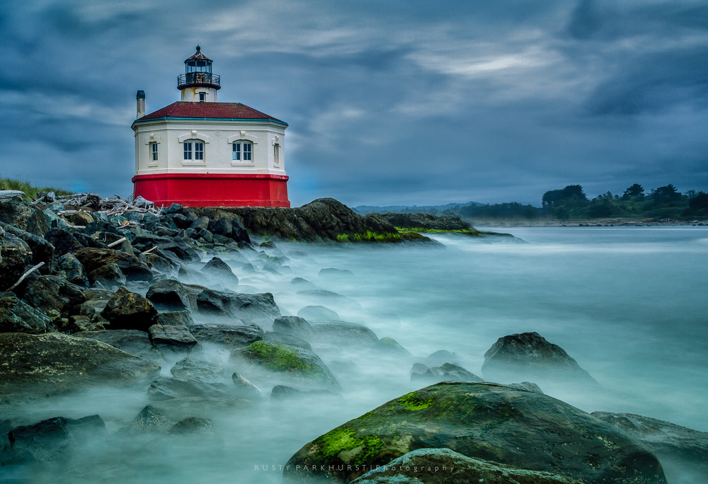Coquille River Light - taken May 21, 2015.  This was a gray, overcast day.  The wind was blowing pretty steadily, splashing waves from the Coquille River against the rocky shore.  To create something a little different, I used a 10-stop graduated filter to achieve a 30 second exposure and transform the waves into mist.