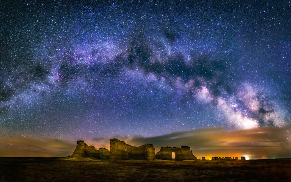 """Monument Rocks Milky Way"" - This is a panoramic image created at Monument Rocks, about 30 miles south of Oakley, Kansas. This was early in the season (March 8), so this was captured very early in the morning, not long before sunrise."