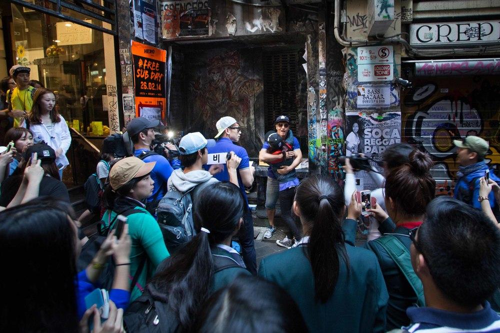 Korean stars Rain and Jong Guk Kim in Degraves St, Melbourne for the filming of South Korean variety TV show 'Running man'.