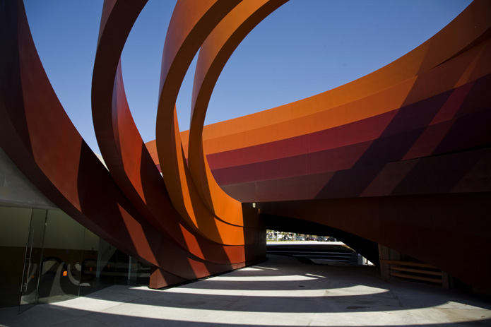 + Design Museum in Holon, Israelby Ron Arad.This is the most marvelous piece of architecture I've seen in a while.