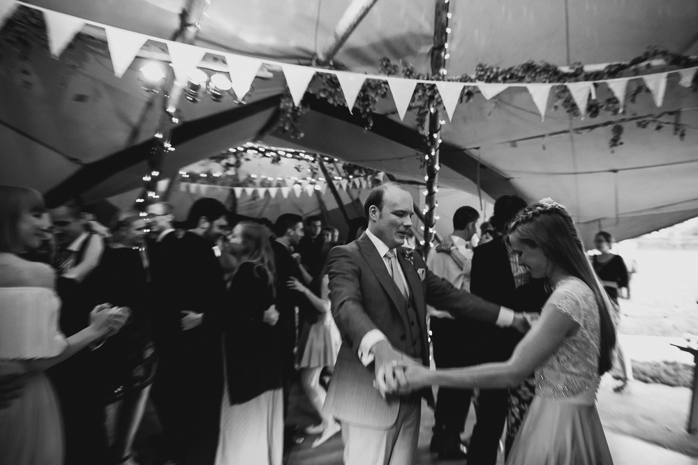 first dance black and white of bride and groom in a tipi wedding