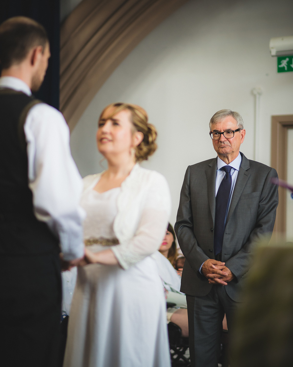 father of bride looking at daughter at wedding ceremony in bristol