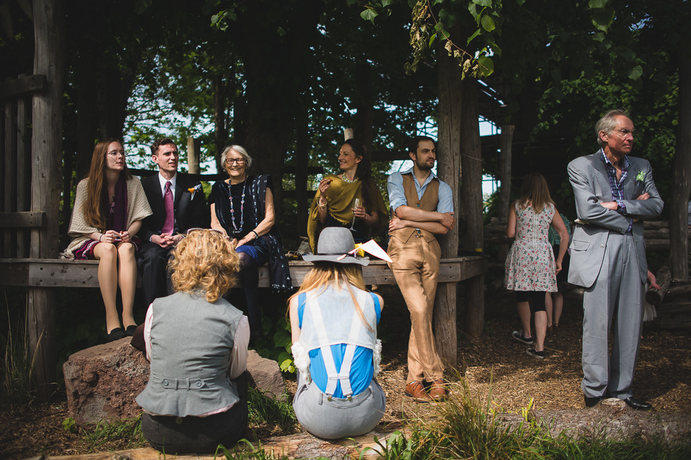 casual wedding guests relaxing on hay bales