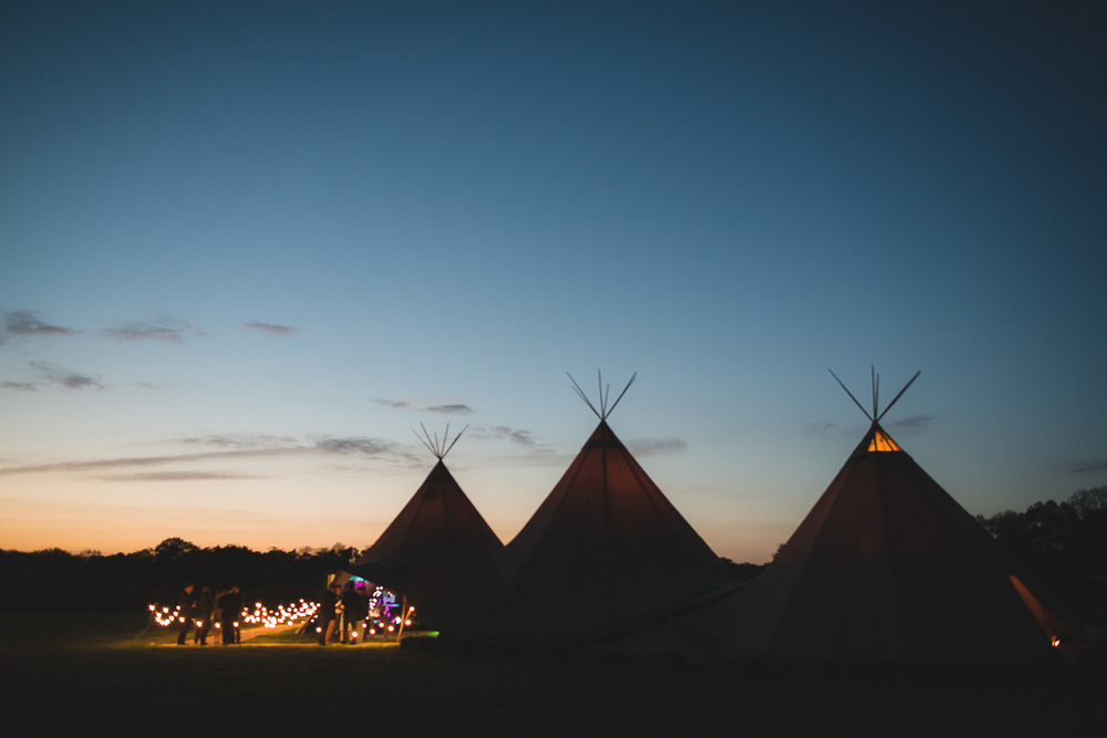 sunset over tipi wedding in a field in sussex