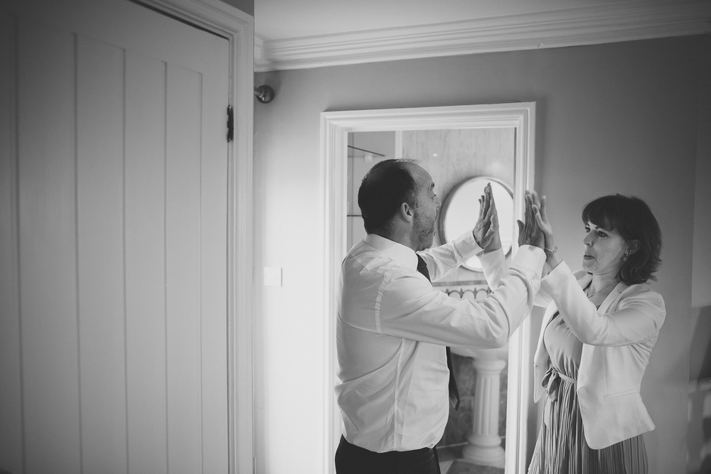 documentary wedding moment of father of the bride high five daughter