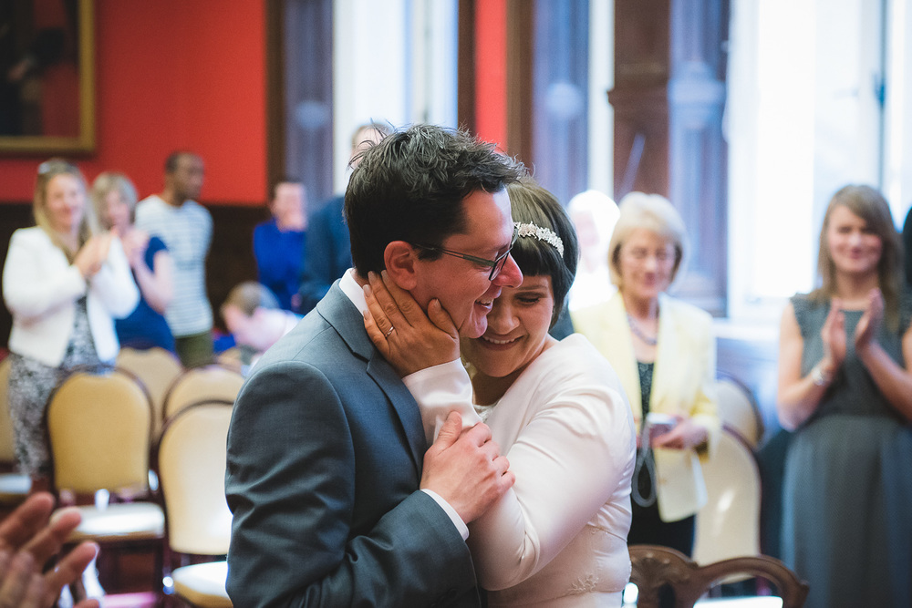 bride hugs groom just after getting married at bristol registry office