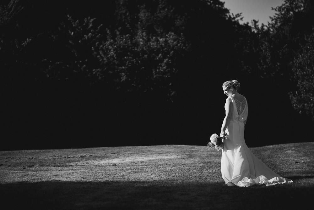 black and white photo of bride in field
