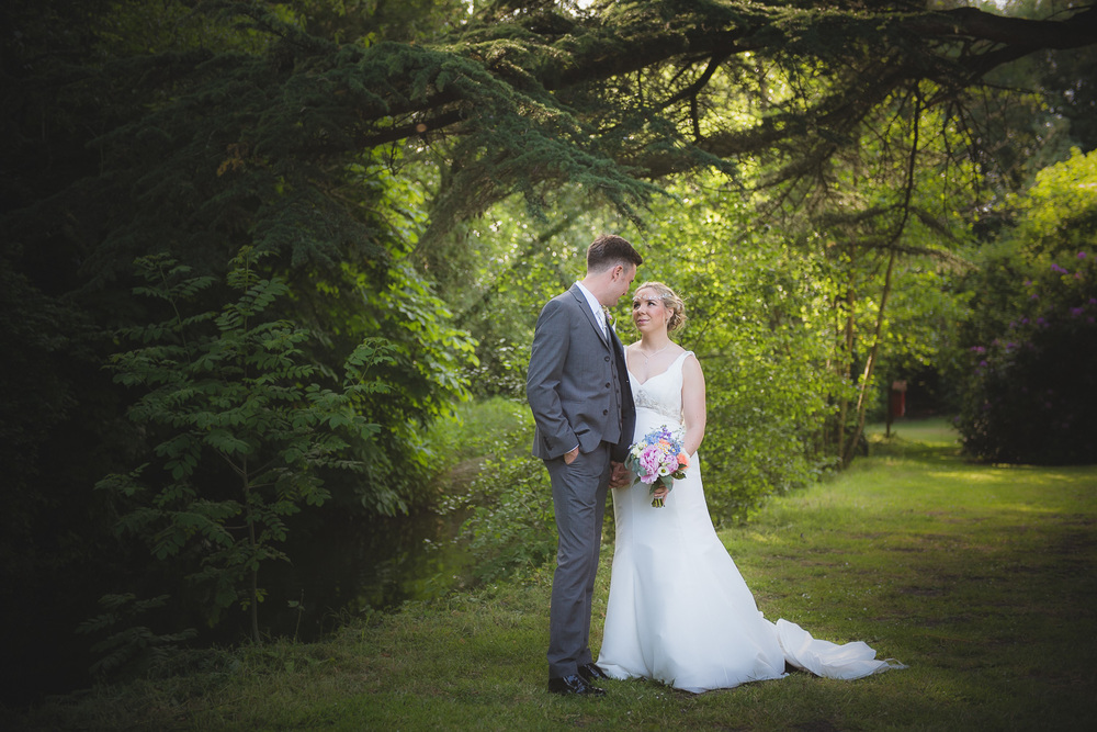romantic photo of bride and groom after outdoor ceremony in wiltshire