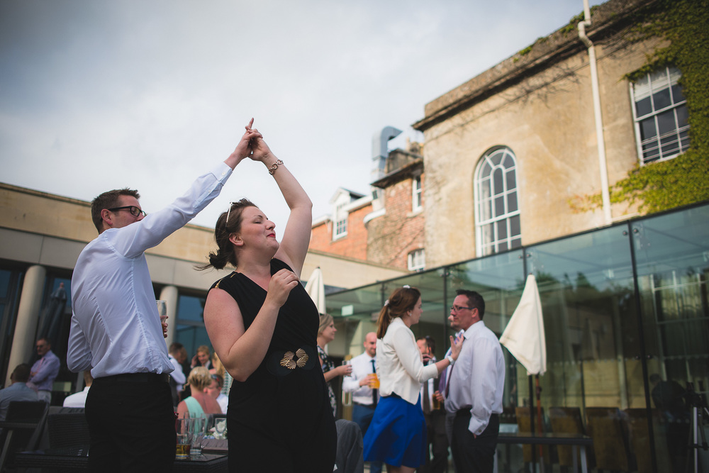 wedding guest dancing to music outdoor reception