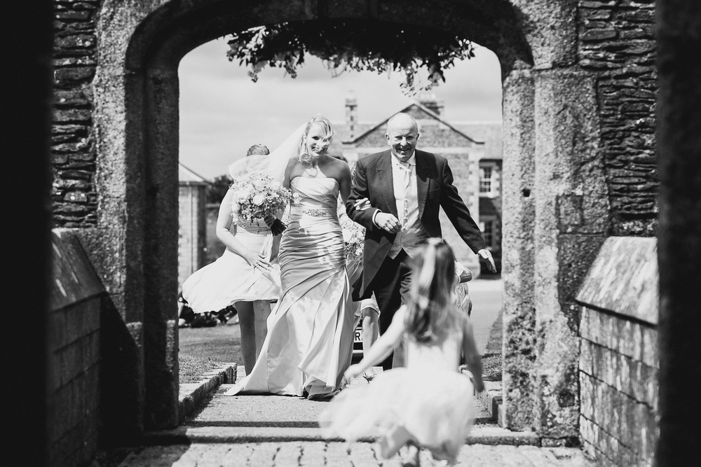 documentary photography of bride arriving at pendennis castle in cornwall