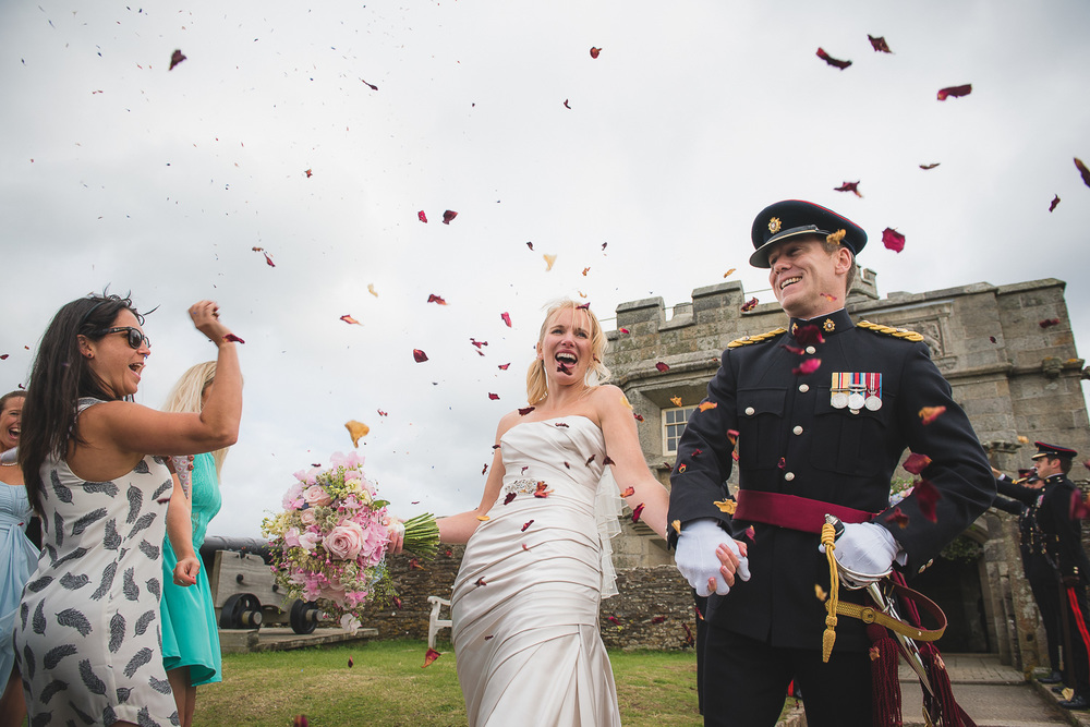 great photography of bride reacting to confetti toss at wedding in cornwall