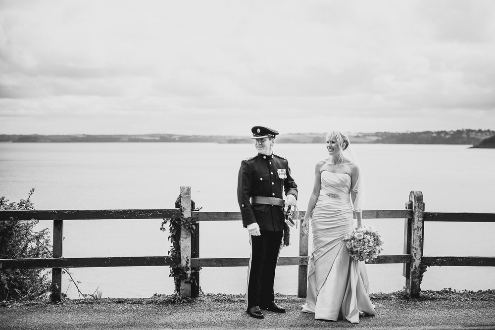 documentary photography of bride and groom by seaside wedding