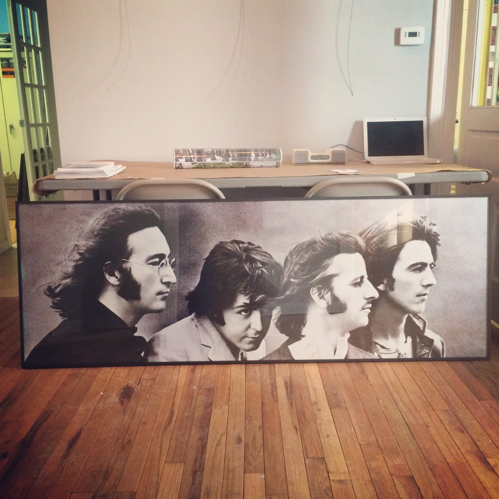 26x74 inch panaramic Beatles poster in aluminum frame.