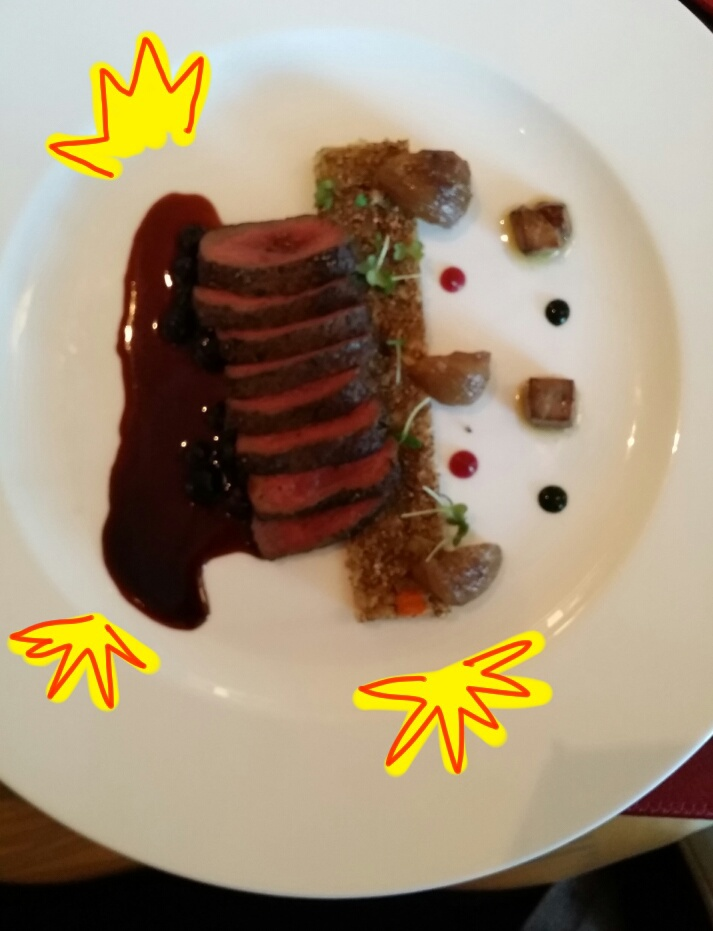 Venison with grains, roasted chestnut and seared foie gras in a huckleberry reduction.