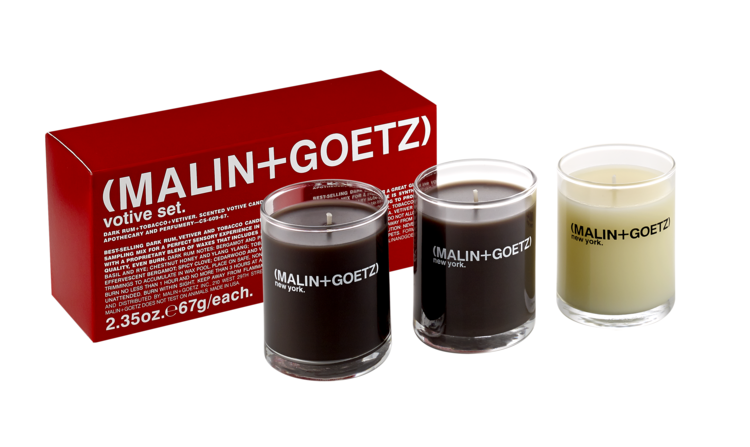 Personalize the hotel suite with Malin+ Goetz votive candles to make the space feel like home.