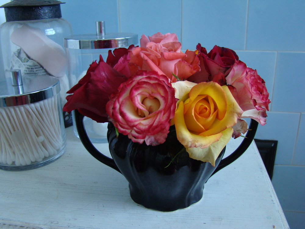 Use leftover blooms, broken stems and discards and make tiny arrangements.  These roses are in a sugar bowl in the bathroom. So pretty and unexpected!