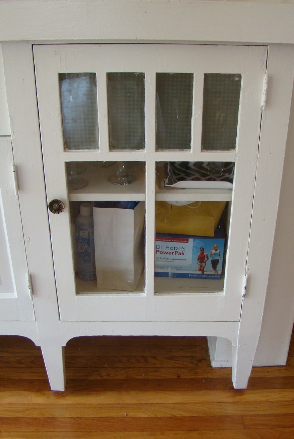 This glass front cabinet is wonderful for storage but doesn't hide any sins.