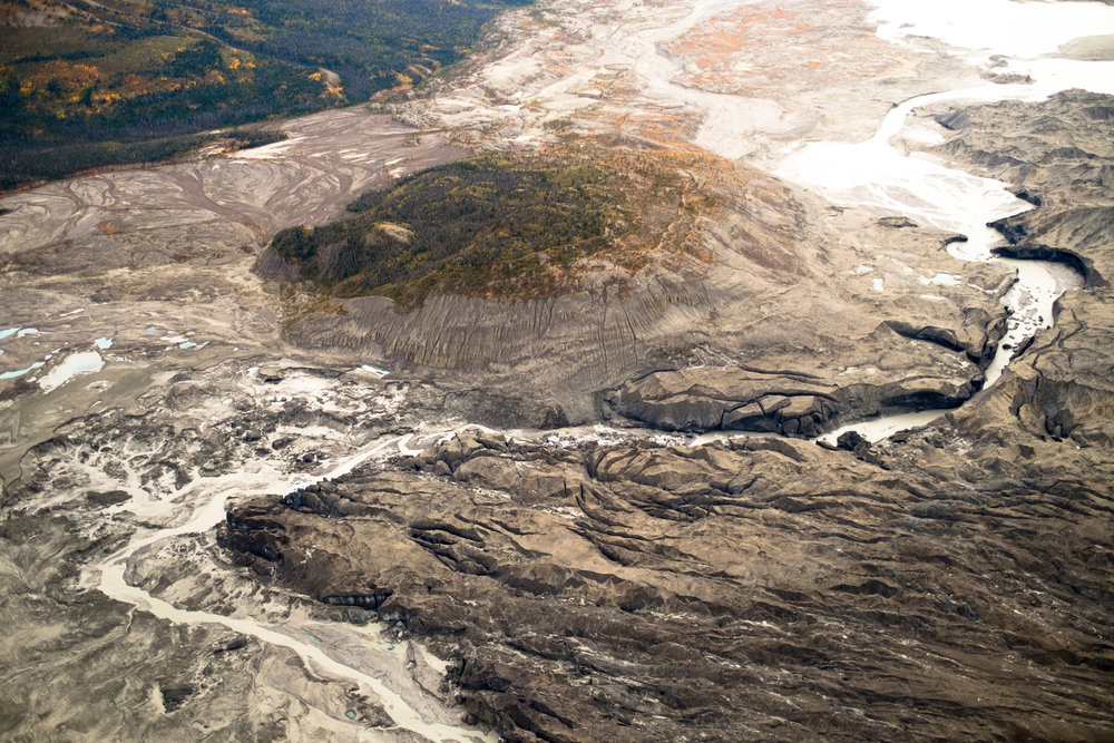 "An aerial view of the ice canyon that now carries meltwater from the Kaskawulsh Glacier, on the right, away from the Slims River. ""River piracy"" refers to one river capturing and diverting the flow of another. (Photo, from the NYT article: Dan Shugar/University of Washington-Tacoma)"