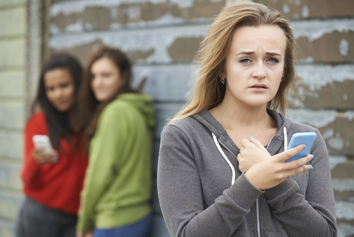 Teen girl trying to with bullying over social media