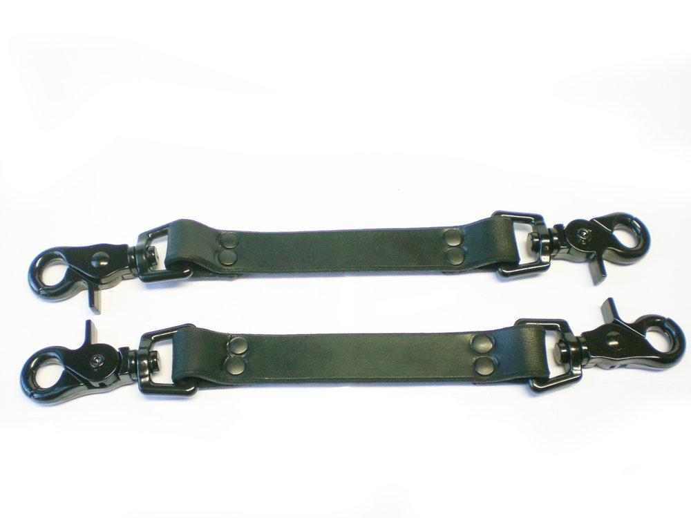 pair of black leather bondage straps