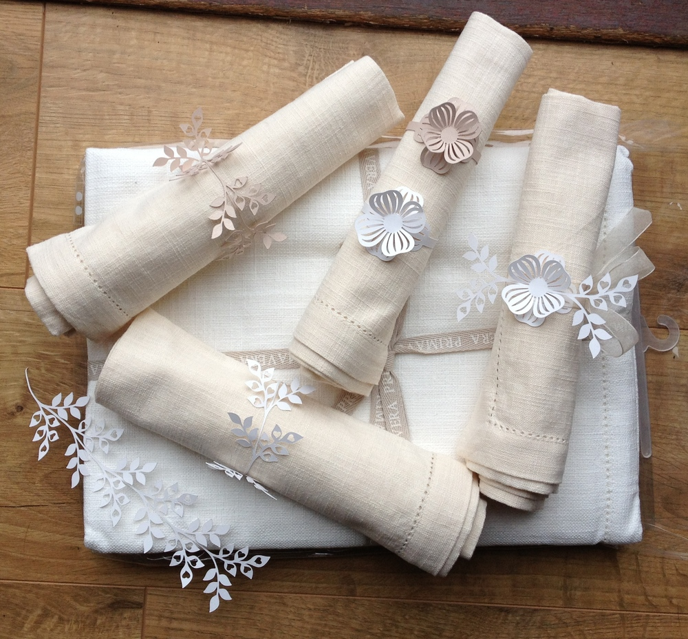 Loving these cut paper napkins  rings - a nice detail for your table setting