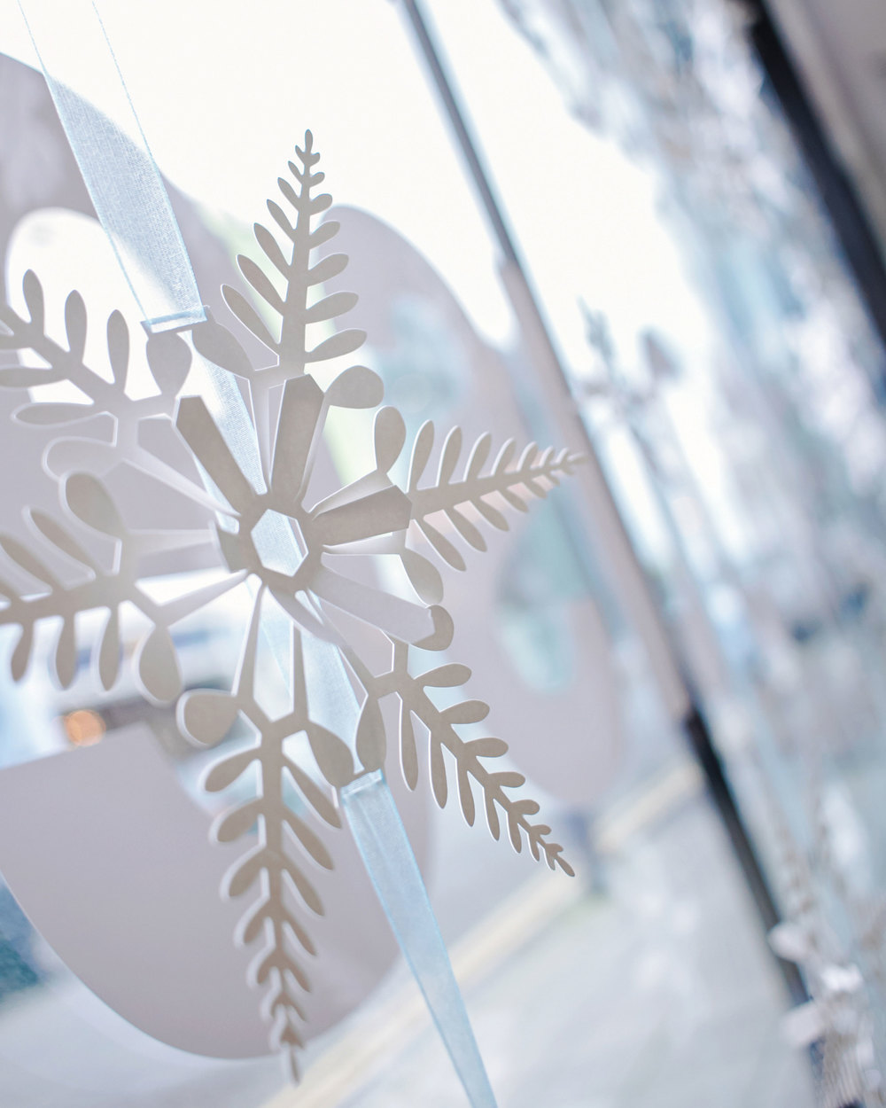 Close up from the foyer window, all the snowflake centres popped out to make a 3D effect. Photography www.bernadettebaksa.com