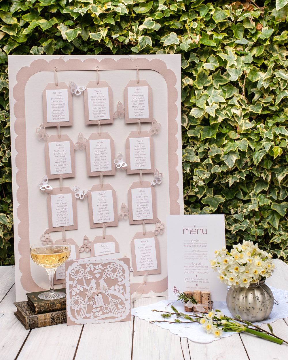 Suspended in a frame by organza ribbon and decorated with fluttering butterflies. This table plan measures 46cm x 64cm